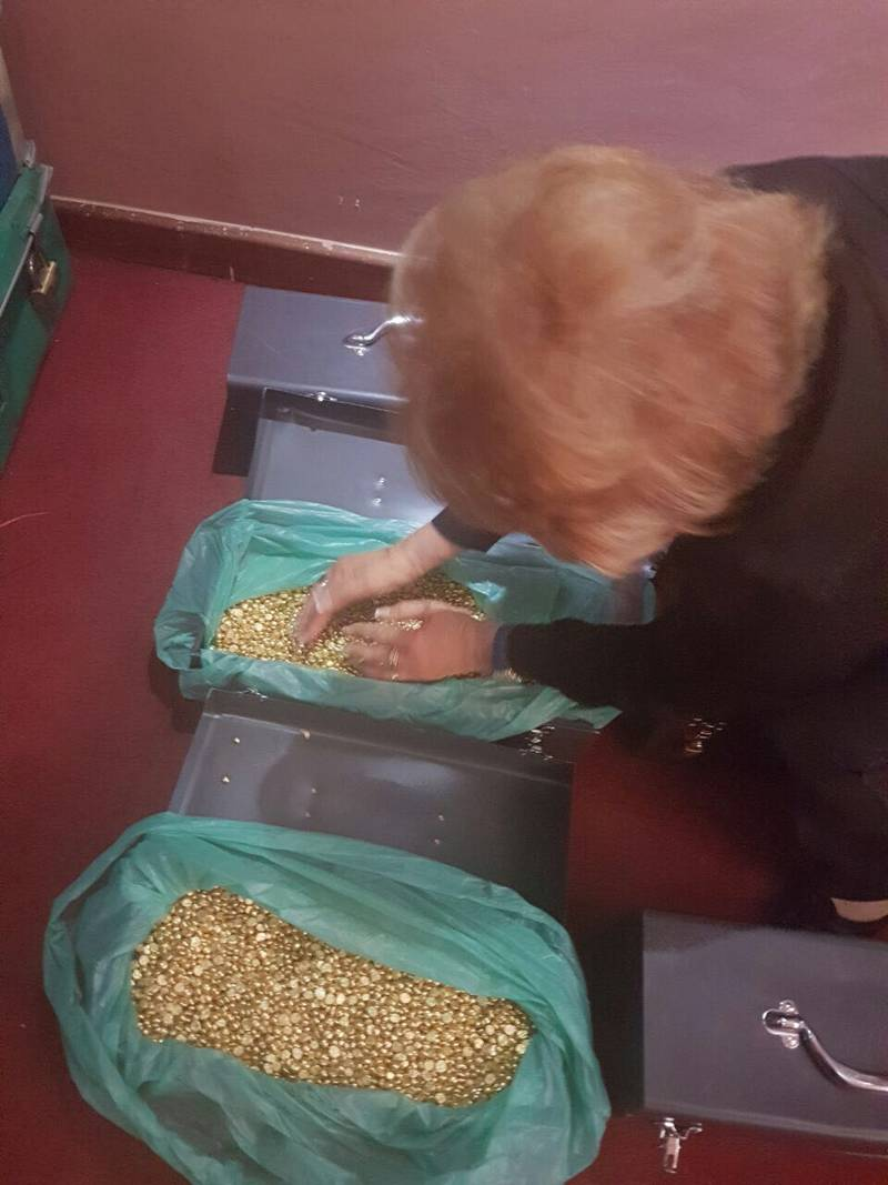Fake gold nuggets from East Africa as grabbed by hands by one of naive believers