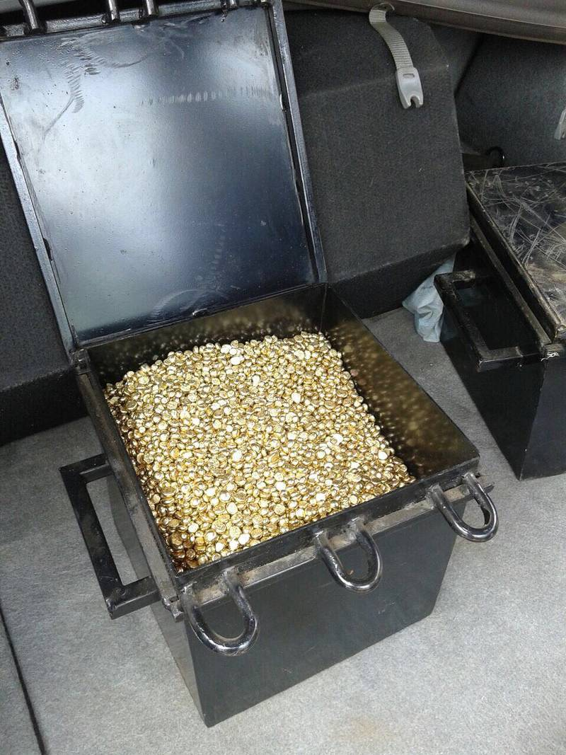 Fake gold nuggets in a box