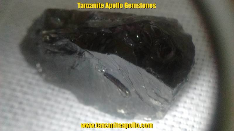 Dark brown color of rough Tanzanite gemstone