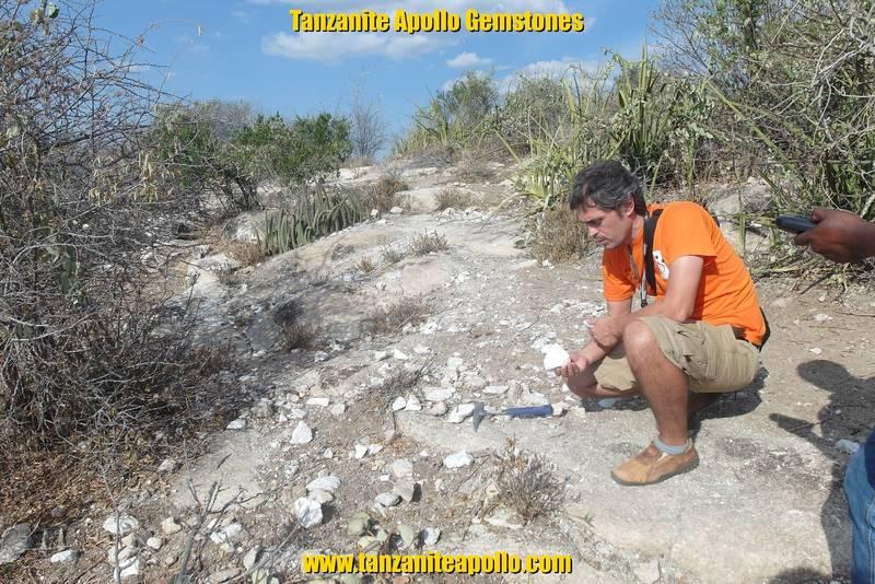 Mr. Jean Louis inspecting rocks