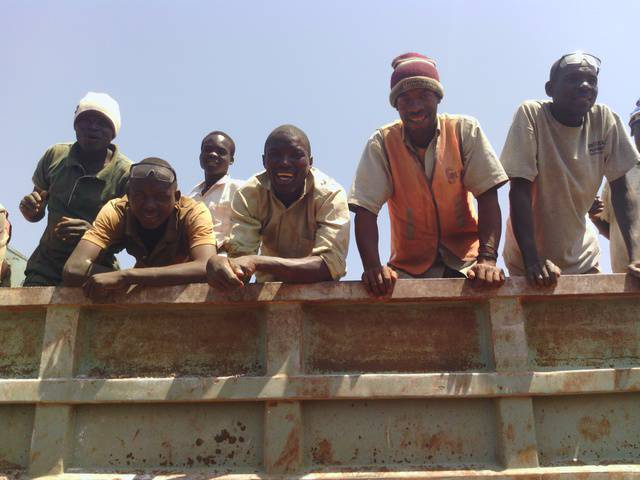 Miners on truck
