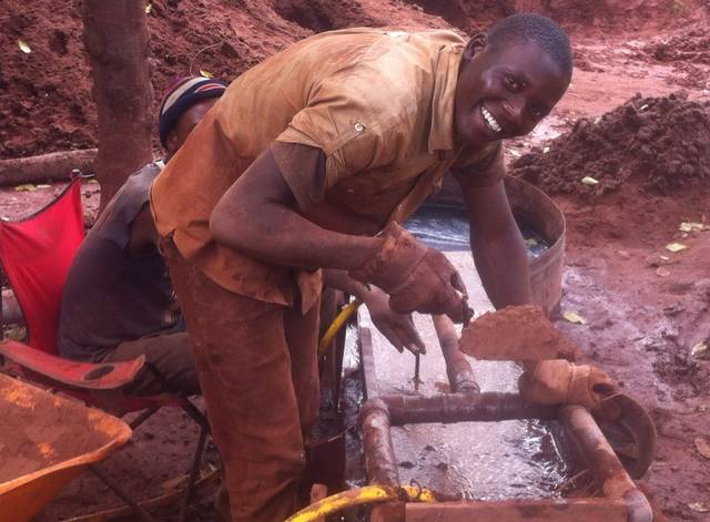 Moses, the initial manager, testing ores on the mining land